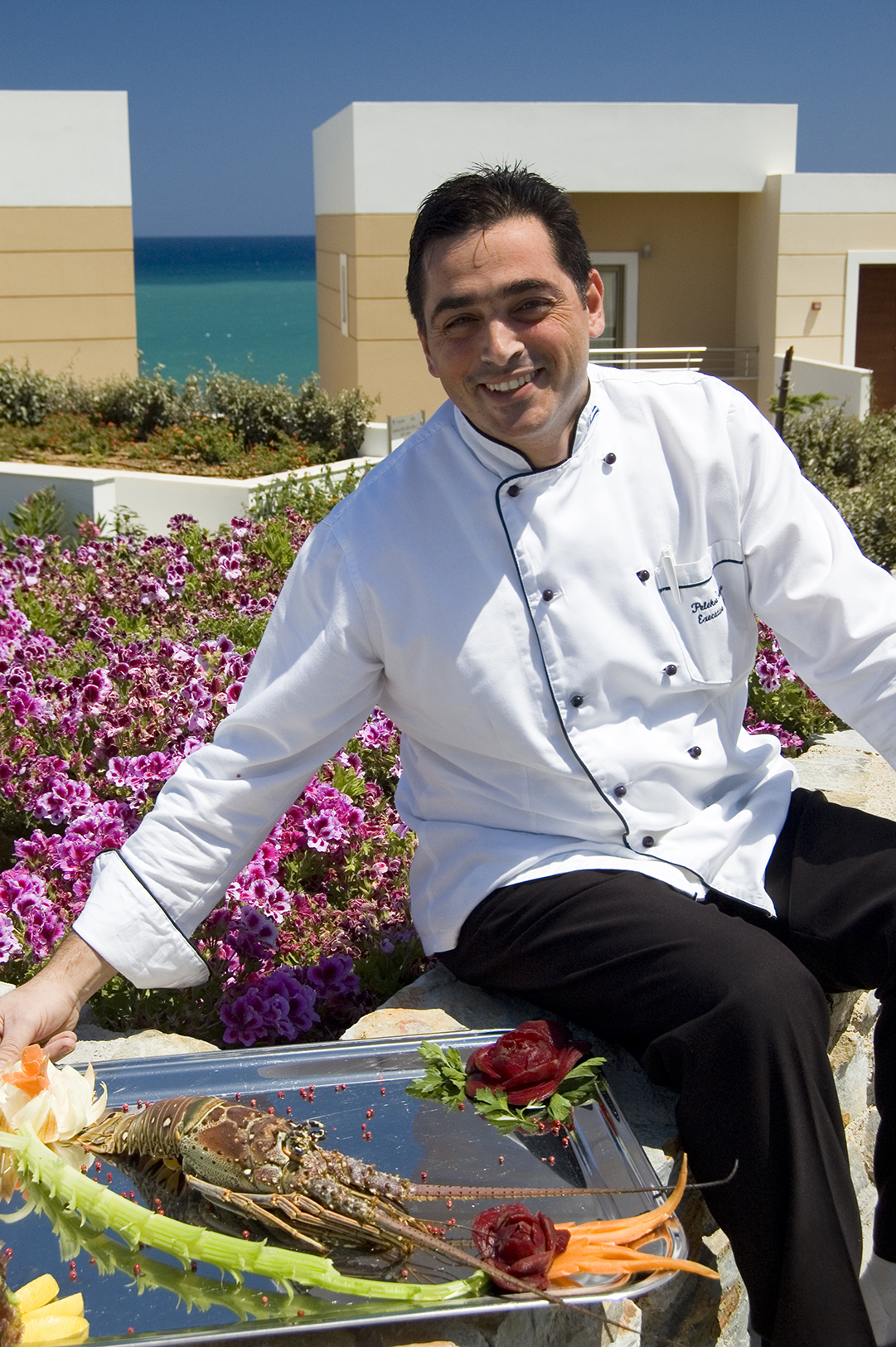 Chef With Seafood Dish At  At Royal Blue Resort
